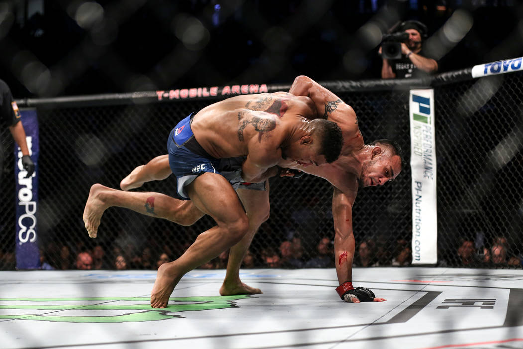 Kevin Lee, left, throws down Tony Ferguson, right, during the interim lightweight championship bout UFC 216 at T-Mobile Arena in Las Vegas, Saturday, Oct. 7, 2017. Ferguson won by submission. Joel ...