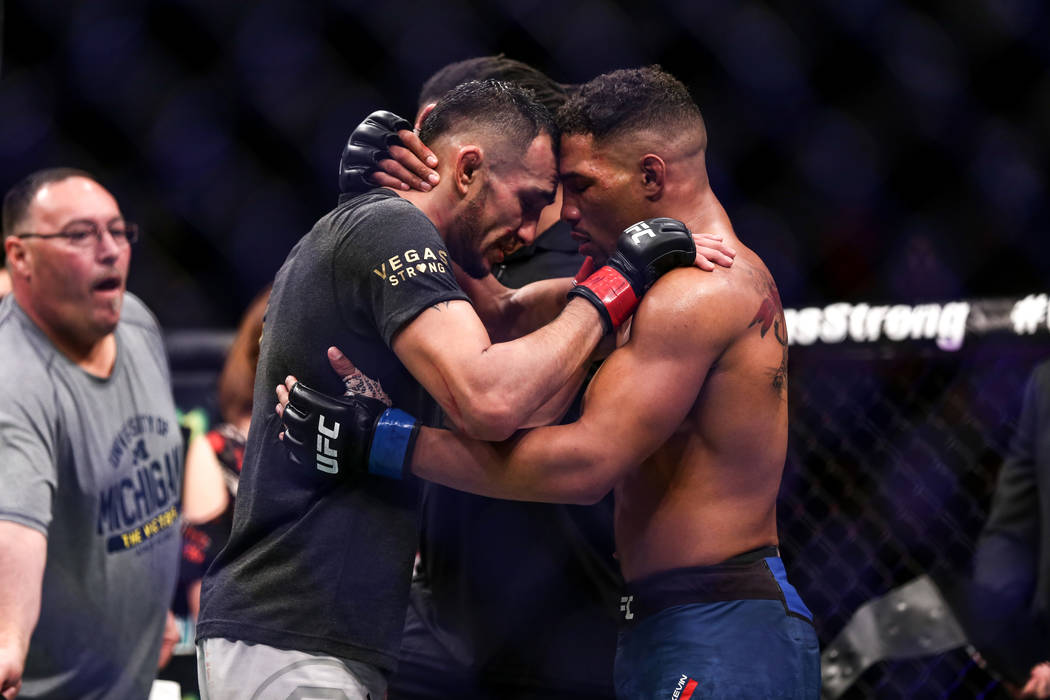 Tony Ferguson, left, and Kevin Lee, right, congratulate each other after the interim lightweight championship bout UFC 216 at T-Mobile Arena in Las Vegas, Saturday, Oct. 7, 2017. Ferguson won by s ...