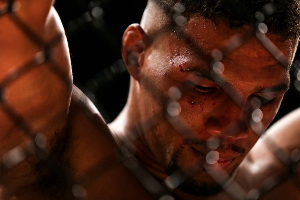 Kevin Lee looks down in defeat after losing to Tony Ferguson for the interim lightweight championship bout UFC 216 at T-Mobile Arena in Las Vegas, Saturday, Oct. 7, 2017. Ferguson won by submissio ...