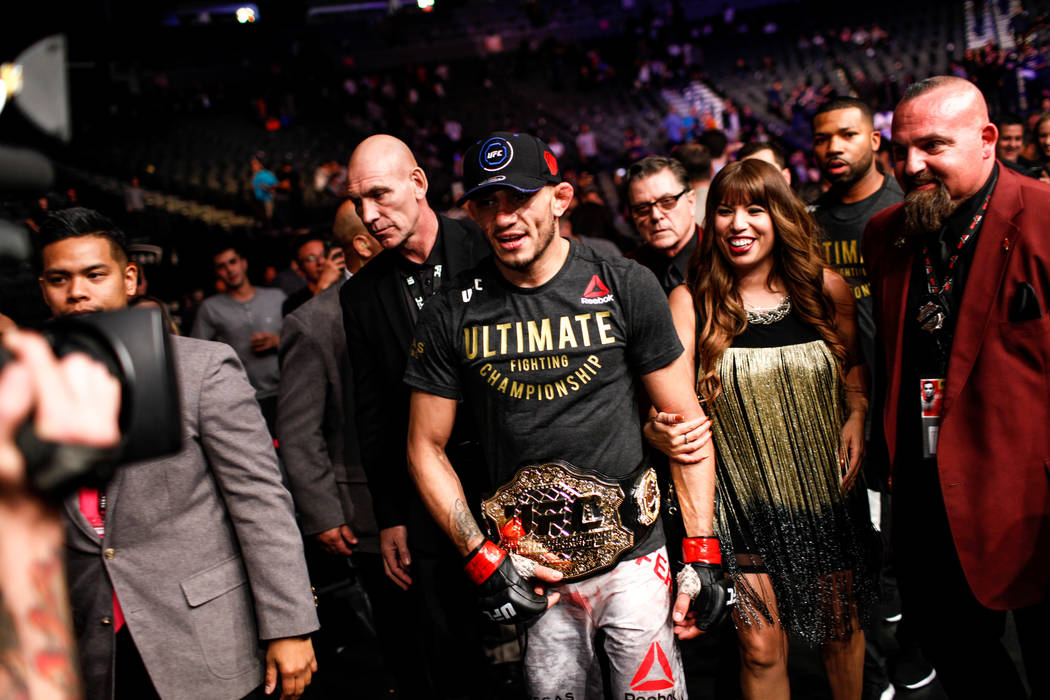 Tony Ferguson walks outside the octagon after defeating Kevin Lee for the interim lightweight championship bout UFC 216 at T-Mobile Arena in Las Vegas, Saturday, Oct. 7, 2017. Ferguson won by subm ...