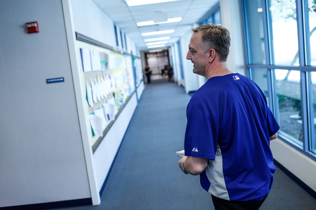 Principal Shawn Halland walks through a hallway at Sandra Lee Thompson Elementary in Las Vegas, Thursday, Oct. 5, 2017. The elementary school is one of two Clark County School District schools to  ...