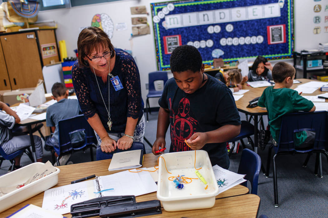 Third Grade Teacher Jacquelyn Howard, left, helps her student Marsche Williams, 8, right, during class at Sandra Lee Thompson Elementary in Las Vegas, Thursday, Oct. 5, 2017. The elementary school ...
