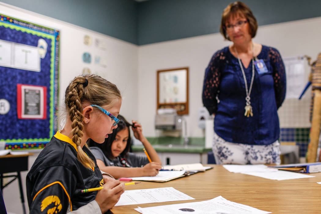 Third grader Kayli Nenno, 8, left, recites her schoolwork to her teacher Jacquelyn Howard, right, during class at Sandra Lee Thompson Elementary in Las Vegas, Thursday, Oct. 5, 2017. The elementar ...