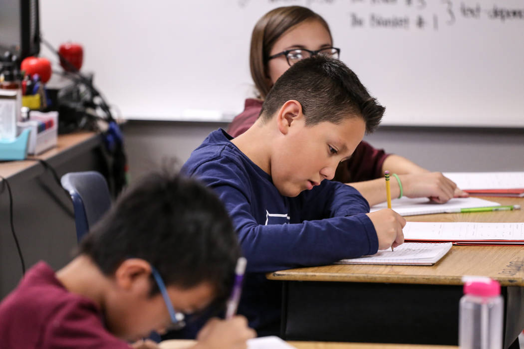 Fifth grader Carter Bulloch works on an assignment at Sandra Lee Thompson Elementary in Las Vegas, Thursday, Oct. 5, 2017. The elementary school is one of two Clark County School District schools  ...