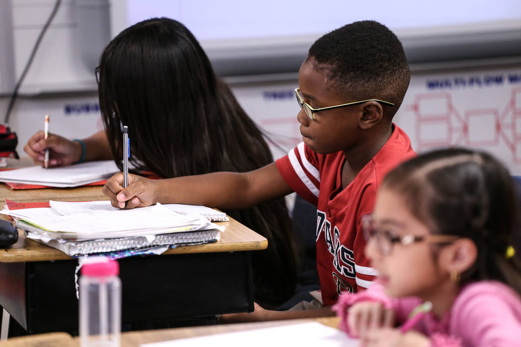 Fifth grader Damian Blake works on an assignment at Sandra Lee Thompson Elementary in Las Vegas, Thursday, Oct. 5, 2017. The elementary school is one of two Clark County School District schools to ...