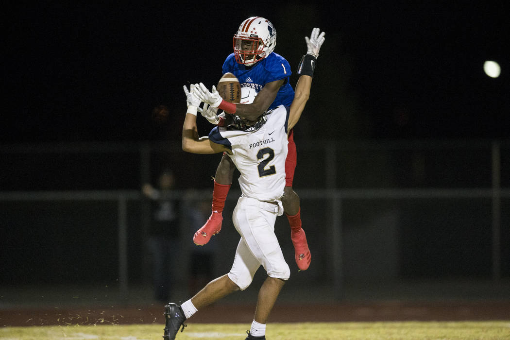 Liberty's Marquez Powell (1) fails to secure a pass runs against Foothill's Jordan Blakely in their football game at Liberty High School in Henderson, Friday, Oct. 6, 2017. Erik Verduzco Las Vegas ...