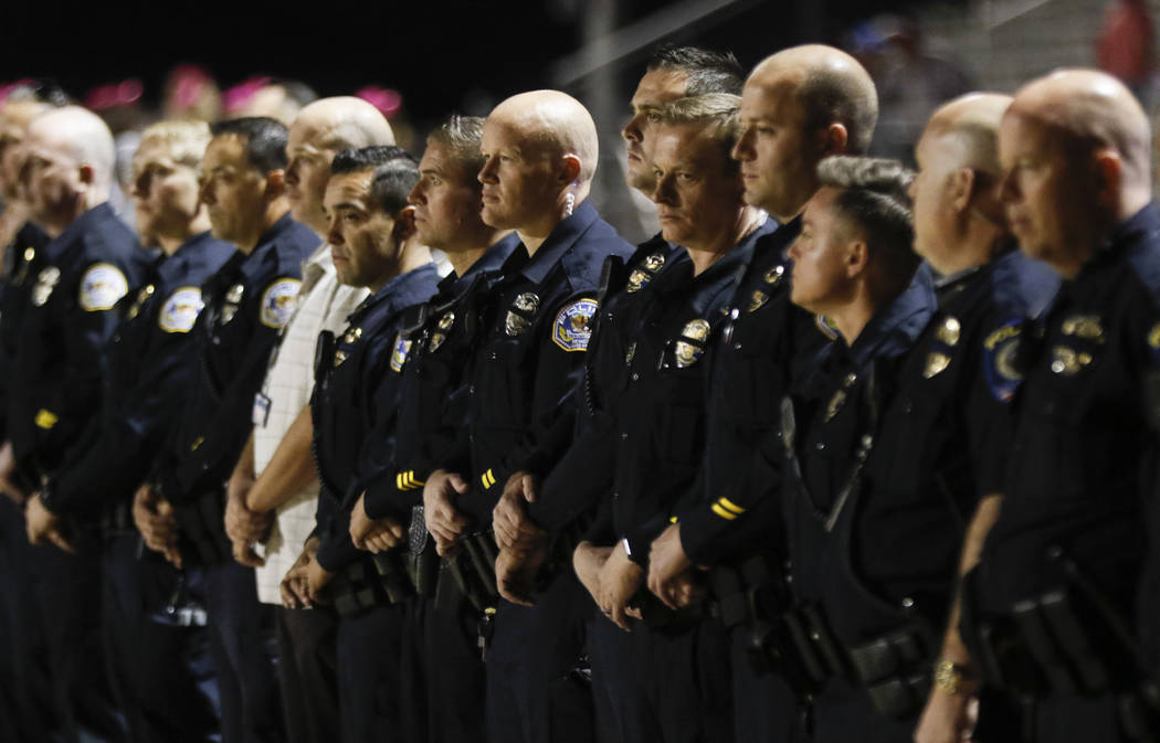 Law enforcement officers gather for fallen Las Vegas police officer Charleston Hartfield before a football game at Basic High School in Henderson on Friday, Oct. 6, 2017. Hartfield died while off- ...
