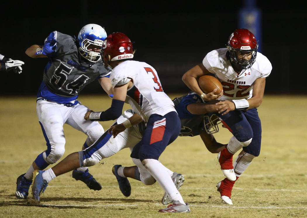 Coronado's Carlos Perez (22) is tackled by a Basic player during a football game at Basic High School in Henderson on Friday, Oct. 6, 2017. Basic won 45-22. Chase Stevens Las Vegas Review-Journal  ...