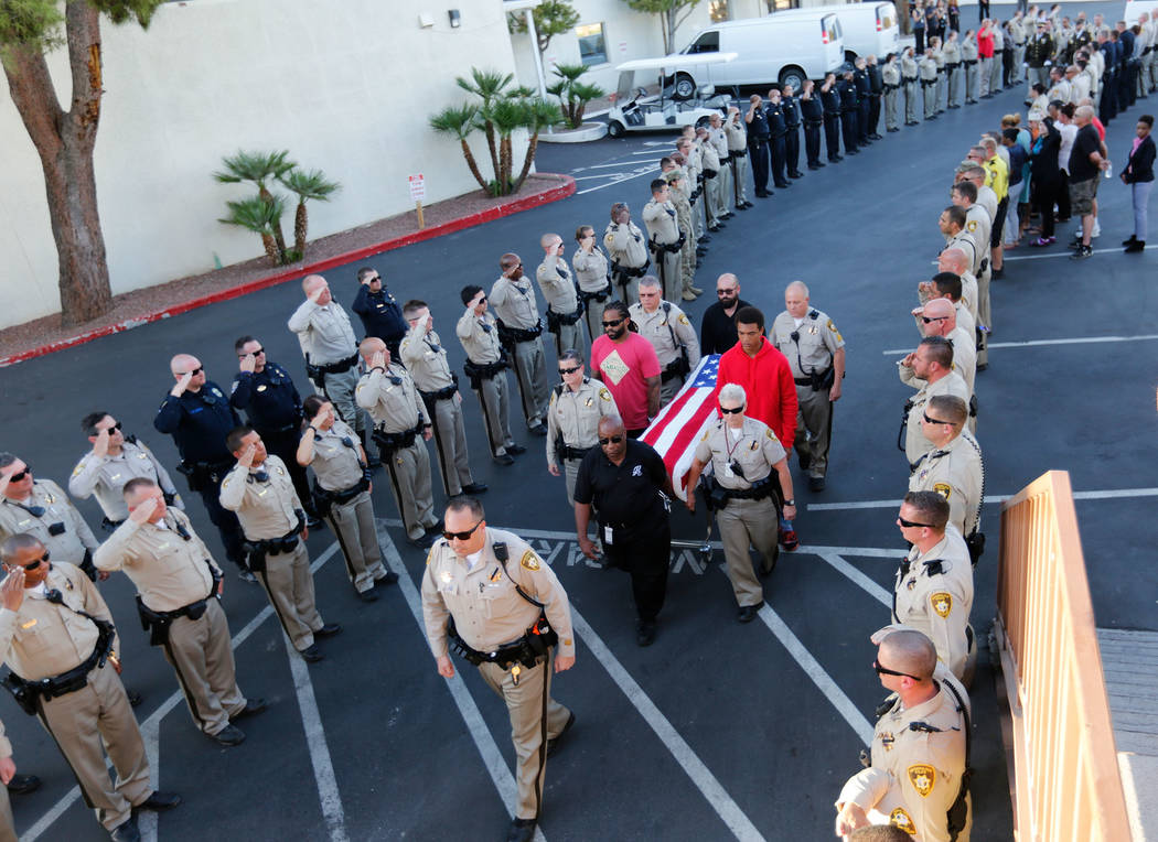 Pallbearers carry the casket of Metropolitan Police Department officer Charleston Hartfield on Tuesday, Oct. 3, 2017, as his casket arrives at Palm Downtown Mortuary and Cemetery in Las Vegas. Har ...