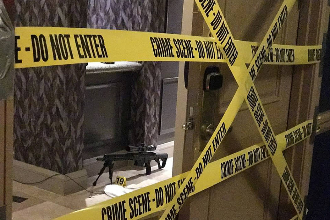 Police tape covers the entrance of a hotel room at Mandalay Bay where Stephen Paddock sprayed bullets down on the crowd at Route 91 Harvest festival on Sunday, Oct. 1, 2017 in Las Vegas. Build
