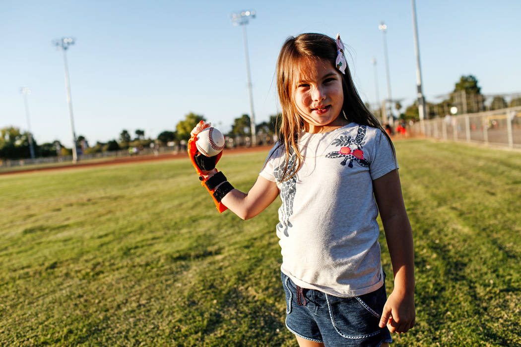 Hailey Dawson, 7, of Henderson at Sunset Park in Las Vegas, Thursday, Oct. 5, 2017. A group of researches at University of Las Vegas created a 3-D prosthetic hand for Dawson, who was born with Pol ...