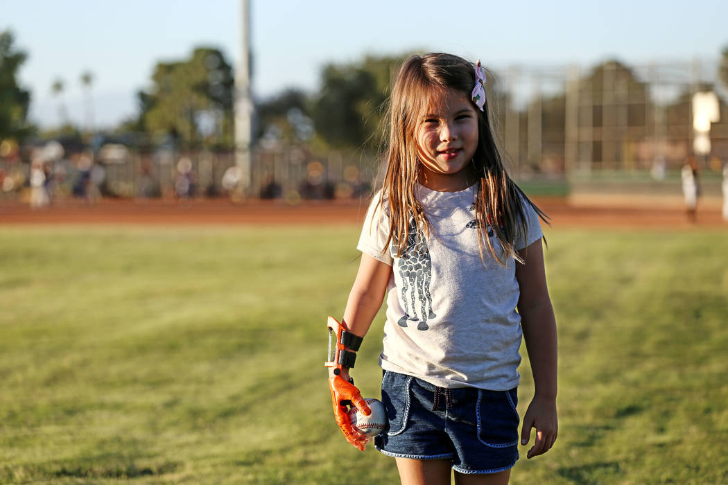 Hailey Dawson, 7, of Henderson poses for a portrait at Sunset Park in Las Vegas, Thursday, Oct. 5, 2017. A group of researches at University of Las Vegas created a 3-D prosthetic hand for Dawson,  ...