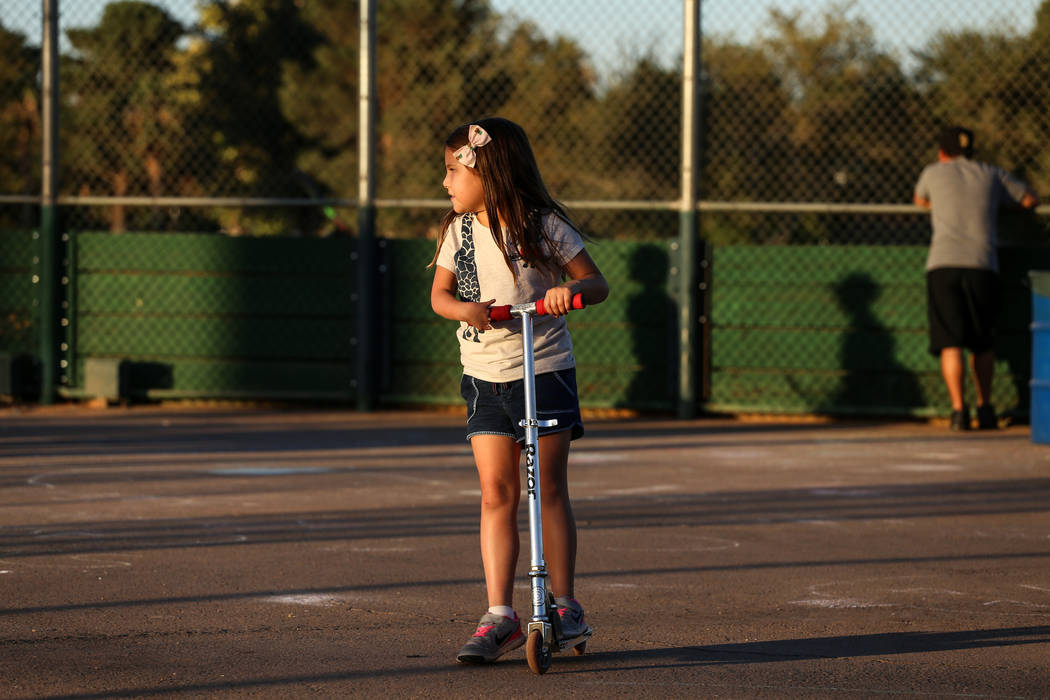 Hailey Dawson, 7, of Henderson rides her scooter at Sunset Park in Las Vegas, Thursday, Oct. 5, 2017. A group of researches at University of Las Vegas created a 3-D prosthetic hand for Dawson, who ...