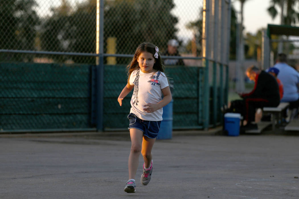 Hailey Dawson, 7, of Henderson runs at Sunset Park in Las Vegas, Thursday, Oct. 5, 2017. A group of researches at University of Las Vegas created a 3-D prosthetic hand for Dawson, who was born wit ...