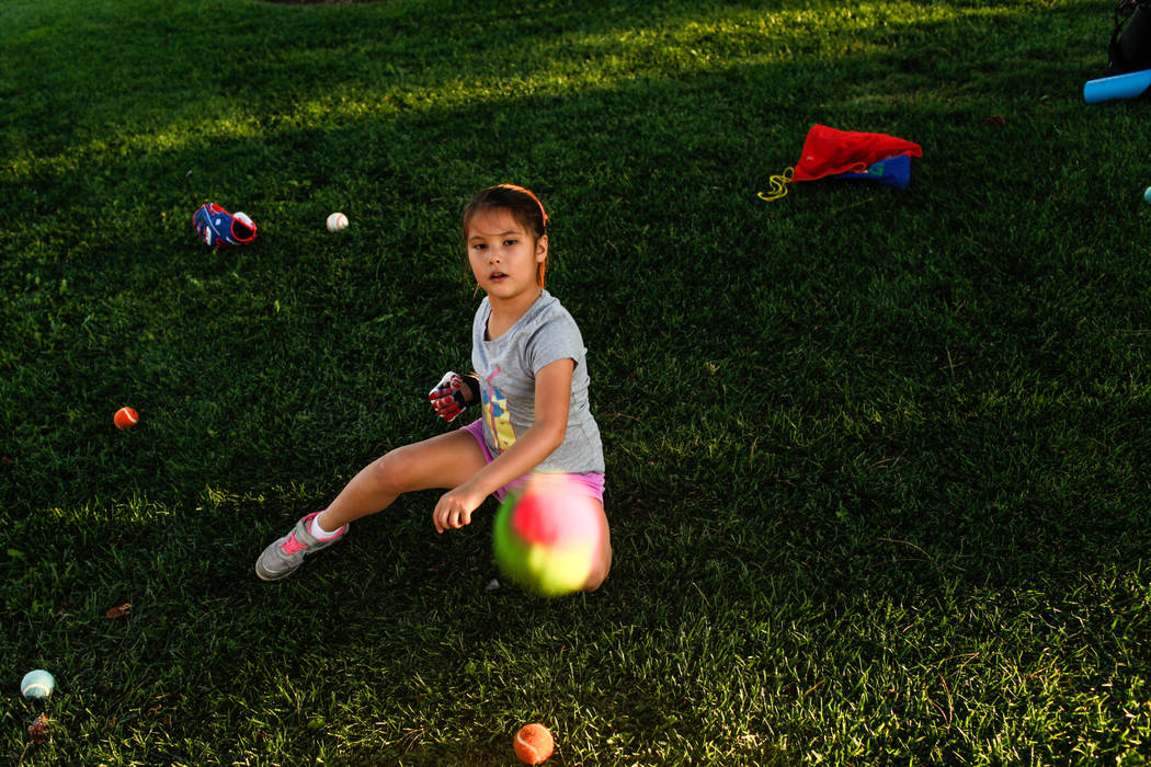 Hailey Dawson, 7, of Henderson, practices her pitch for the MLB World Series opener during a session at Anthem Hills Park in Henderson, Thursday, Oct. 19, 2017. A group of researches at University ...