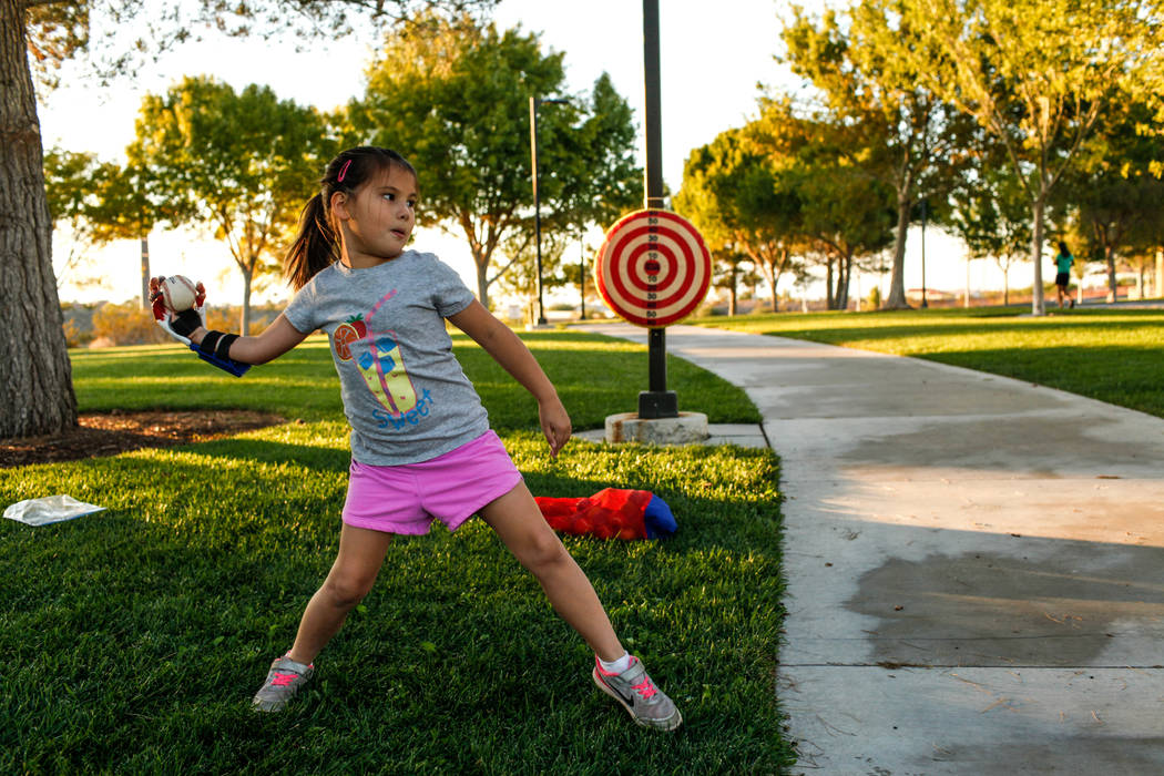 Hailey Dawson, 7, practices her pitch for the MLB World Series opener during a session at Anthem Hills Park in Henderson, Thursday, Oct. 19, 2017. A group of researches at University of Las Vegas  ...