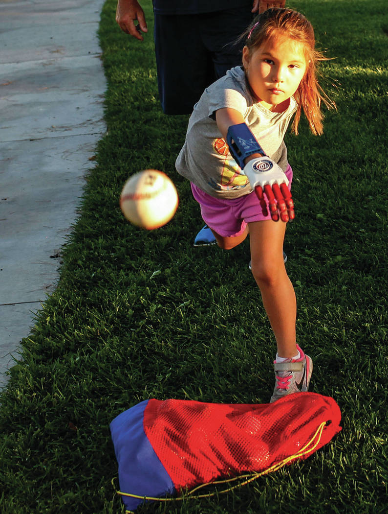 Hailey Dawson, 7, of Henderson, front, practices her pitch for the MLB World Series opener during a session at Anthem Hills Park in Henderson, Thursday, Oct. 19, 2017. A group of researches at Uni ...