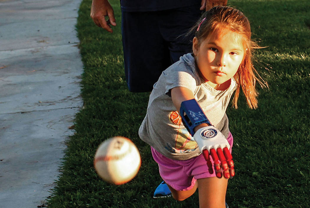 Hailey Dawson, 7, of Henderson, front, practices her pitch for the MLB World Series opener during a session at Anthem Hills Park in Henderson, Thursday, Oct. 19, 2017. (Joel Angel Juarez Las Vegas ...