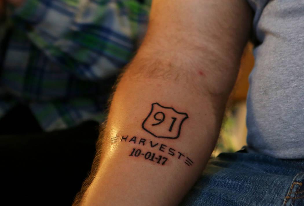 Vigil attendee s tattoo serves as reminder of survival for Las vegas tattoo
