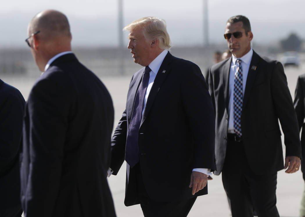 President Donald Trump arrives at McCarran International Airport in Las Vegas on Wednesday, Oct. 4, 2017. A gunman opened fire on attendees of a music festival Sunday night, resulting in the death ...