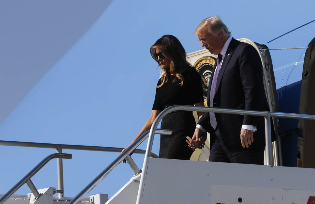 President Donald Trump arrives with First Lady Melania Trump at McCarran International Airport in Las Vegas on Wednesday, Oct. 4, 2017. A gunman opened fire on attendees of a music festival Sunday ...