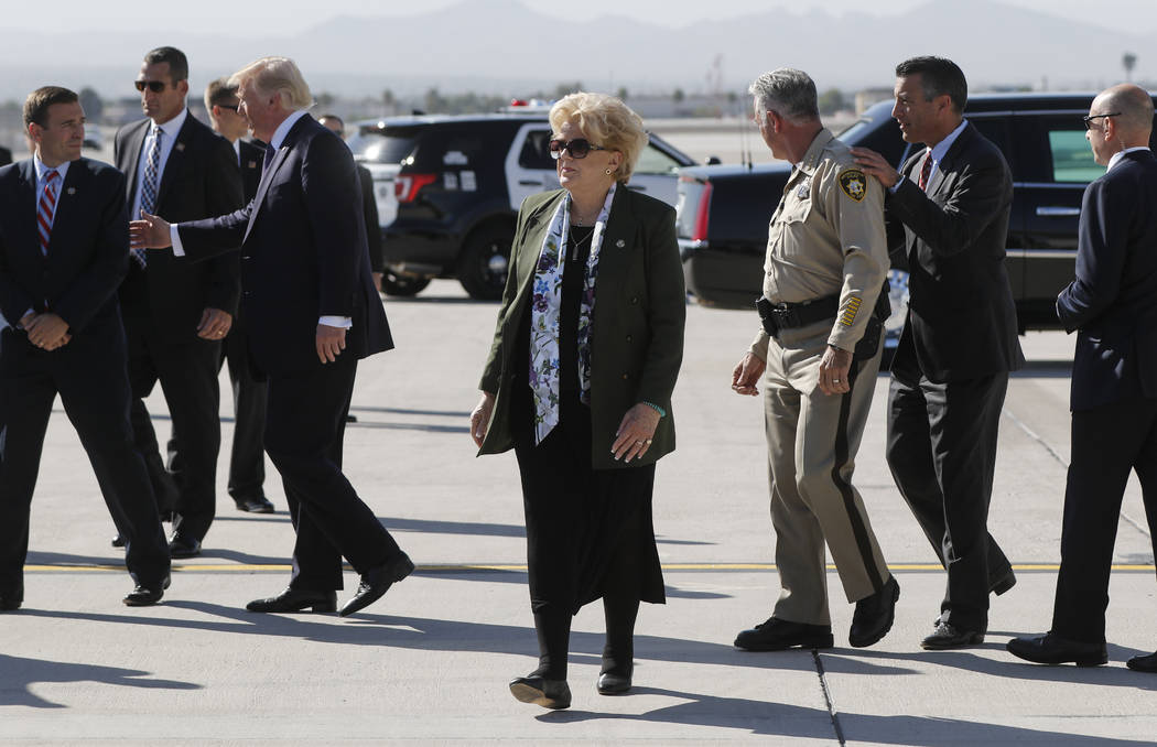 Las Vegas Mayor Carolyn Goodman, center, after the arrival of President Donald Trump at McCarran International Airport on Wednesday, Oct. 4, 2017. A gunman opened fire on attendees of a music fest ...