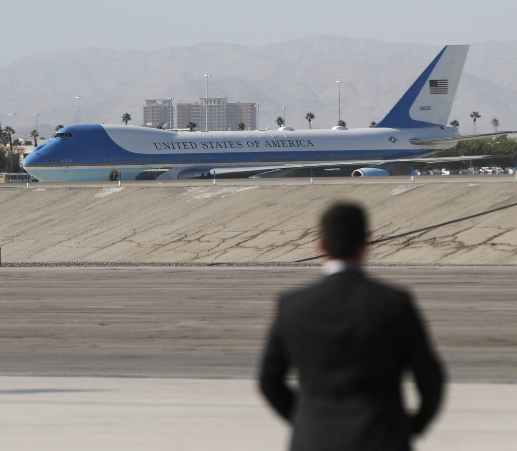 Air Force One arrives at McCarran International Airport in Las Vegas on Wednesday, Oct. 4, 2017. A gunman opened fire on attendees of a music festival Sunday night, resulting in the death of 59 pe ...