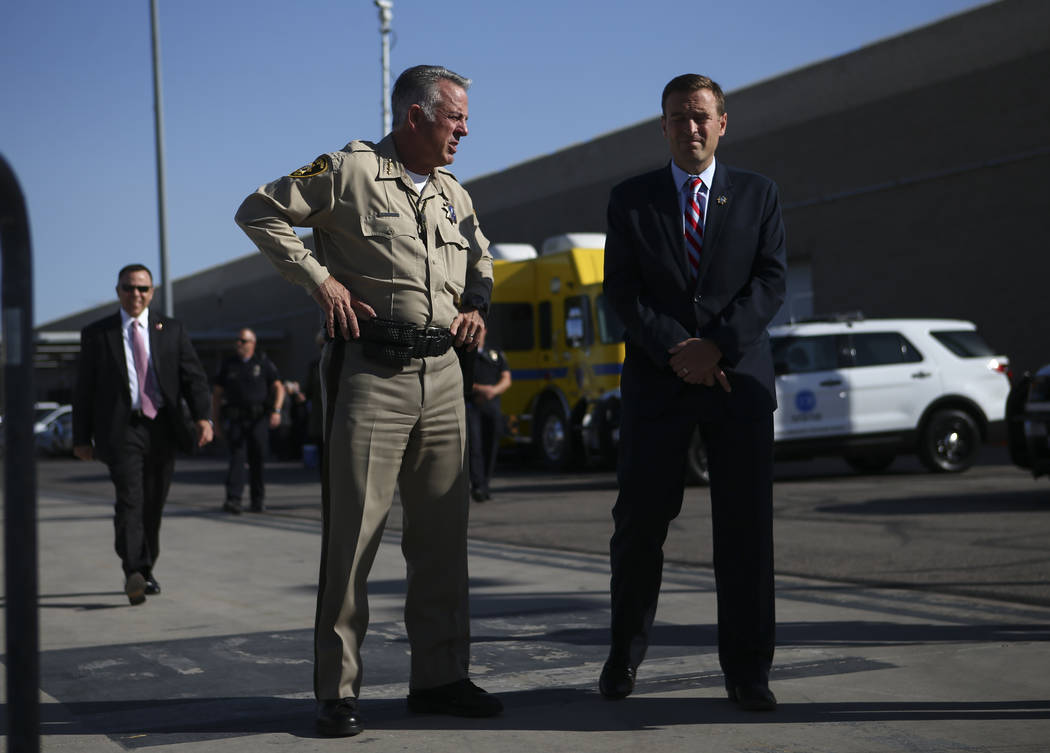 Clark County Sheriff Joe Lombardo, left, and Nevada Attorney General Adam Laxalt wait for the arrival of President Donald Trump at McCarran International Airport in Las Vegas on Wednesday, Oct. 4, ...