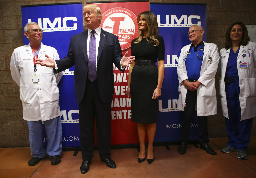 President Donald Trump and First Lady Melania Trump after visiting victims at University Medical Center in Las Vegas on Wednesday, Oct. 4, 2017. A gunman opened fire on attendees of a music festiv ...