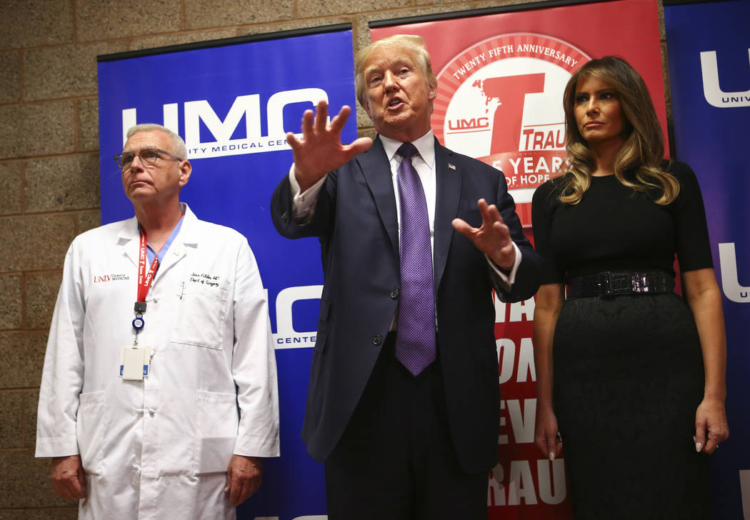 President Donald Trump and First Lady Melania Trump alongside physician John Fildes, left, after visiting victims at University Medical Center in Las Vegas on Wednesday, Oct. 4, 2017. A gunman ope ...