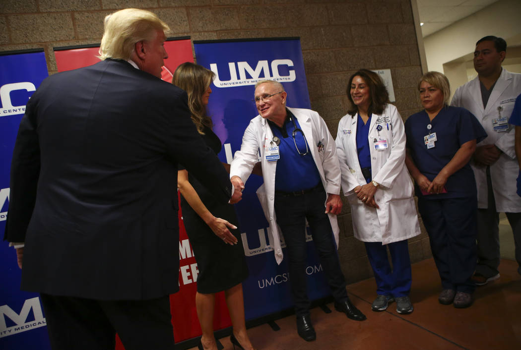 President Donald Trump shakes hands with physicians after visiting victims at University Medical Center in Las Vegas on Wednesday, Oct. 4, 2017. A gunman opened fire on attendees of a music festiv ...