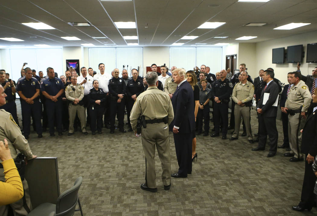 Clark County Sheriff Joe Lombardo and President Donald Trump at Metropolitan Police Department headquarters in Las Vegas on Wednesday, Oct. 4, 2017. A gunman opened fire on attendees of a music fe ...