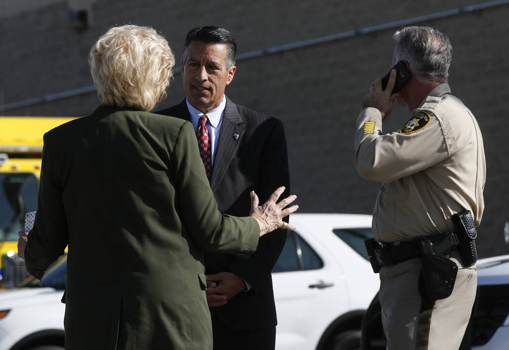 Mayor Carolyn Goodman, from left, Gov. Brian Sandoval, and Clark County Sheriff Joe Lombardo wait for the arrival of President Donald Trump at McCarran International Airport in Las Vegas on Wednes ...