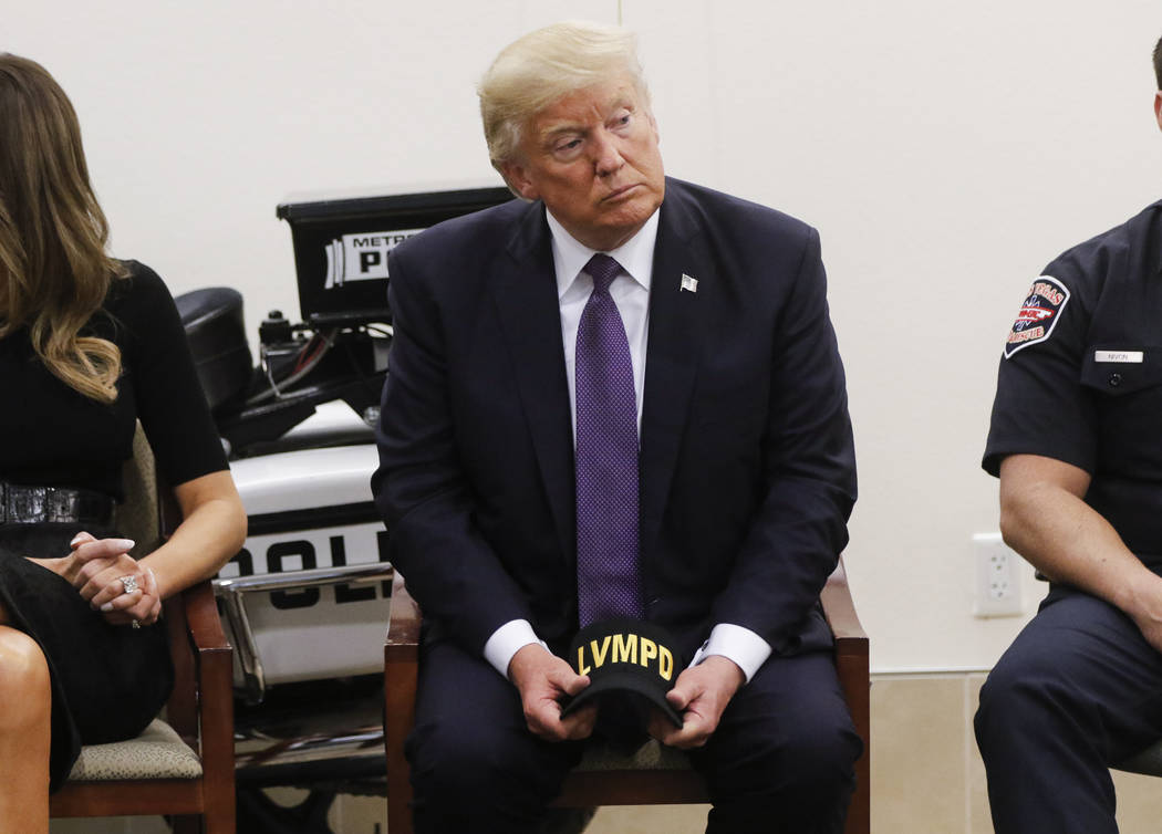 President Donald Trump visits with first responders at Metropolitan Police Department headquarters in Las Vegas on Wednesday, Oct. 4, 2017. A gunman opened fire on attendees of a music festival Su ...