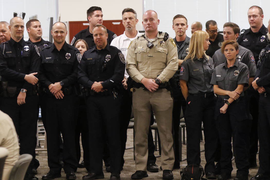 Law enforcement officers wait to be greeted by President Donald Trump and first lady Melania Trump at Metropolitan Police Department headquarters in Las Vegas on Wednesday, Oct. 4, 2017. A gunman  ...