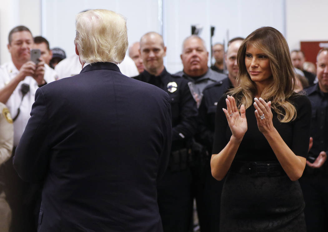 President Donald Trump and first lady Melania Trump visit with law enforcement officers at Metropolitan Police Department headquarters in Las Vegas on Wednesday, Oct. 4, 2017. A gunman opened fire ...