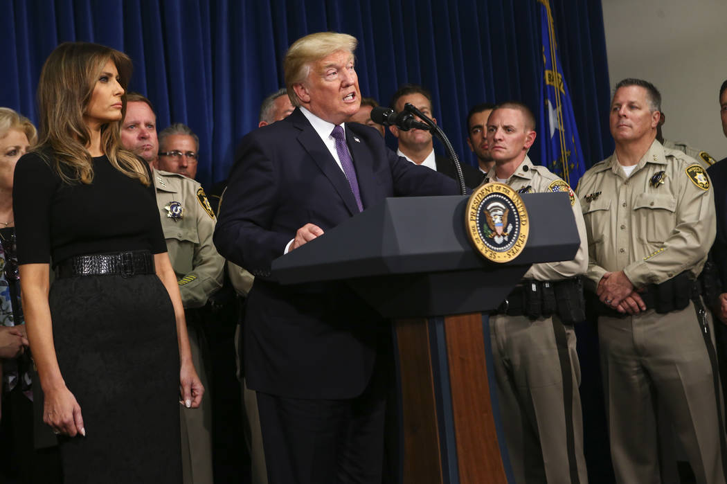 President Donald Trump, with first lady Melania Trump, speaks at Metropolitan Police Department headquarters in Las Vegas on Wednesday, Oct. 4, 2017. A gunman opened fire on attendees of a music f ...
