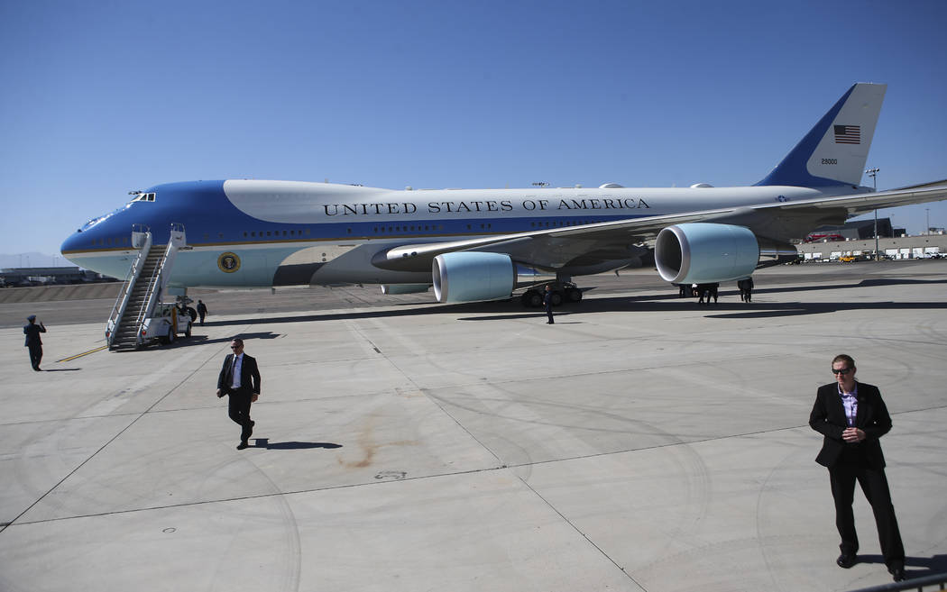 Air Force One prepares to depart from McCarran International Airport after President Donald Trump visited with victims and first responders in Las Vegas on Wednesday, Oct. 4, 2017. A gunman opened ...