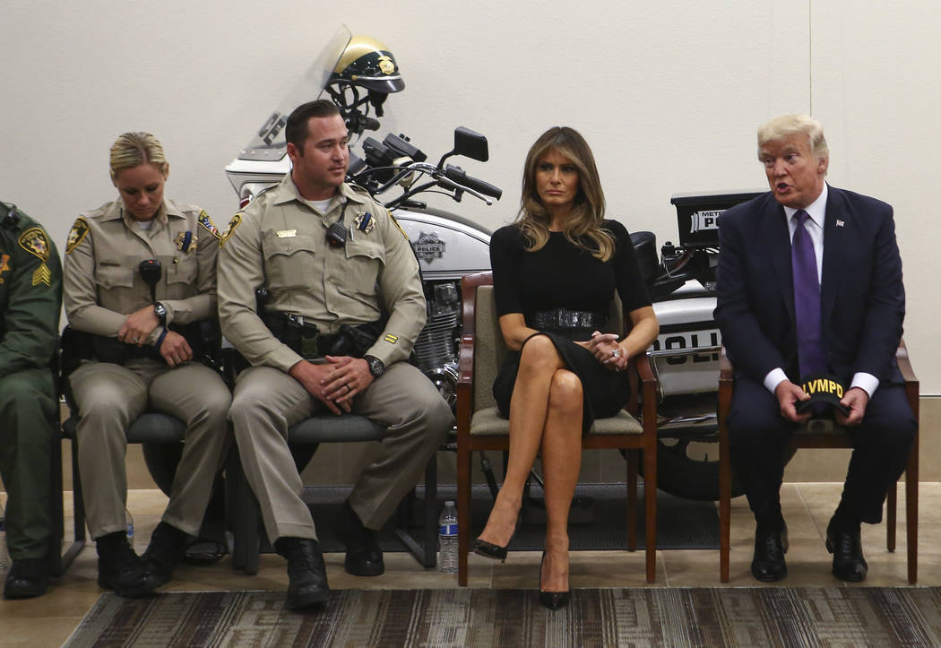 President Donald Trump and first lady Melania Trump visit with first responders at Metropolitan Police Department headquarters in Las Vegas on Wednesday, Oct. 4, 2017. A gunman opened fire on atte ...