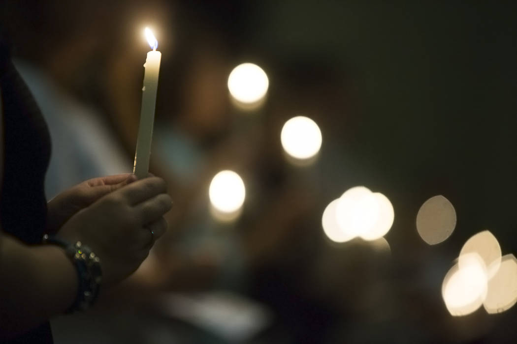 Guests at Good Samaritan Lutheran Church pray during a candlelight service in response to Sunday's Route 91 festival shooting on Tuesday, October 3, 2017, in Las Vegas. Benjamin Hager Las Vegas Re ...