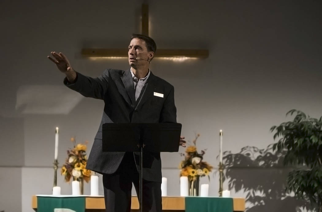 Pastor Don Lorfing, of Good Samaritan Lutheran Church, leads prayer during a candlelight service in response to Sunday's Route 91 festival shooting on Tuesday, October 3, 2017, in Las Vegas. Benja ...