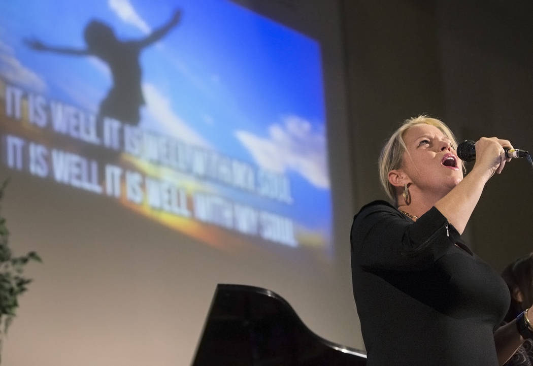 Kristin Puhl leads the congregation in song during a candlelight service in response to Sunday's Route 91 festival shooting on Tuesday, October 3, 2017, at Good Samaritan Lutheran Church, in Las V ...