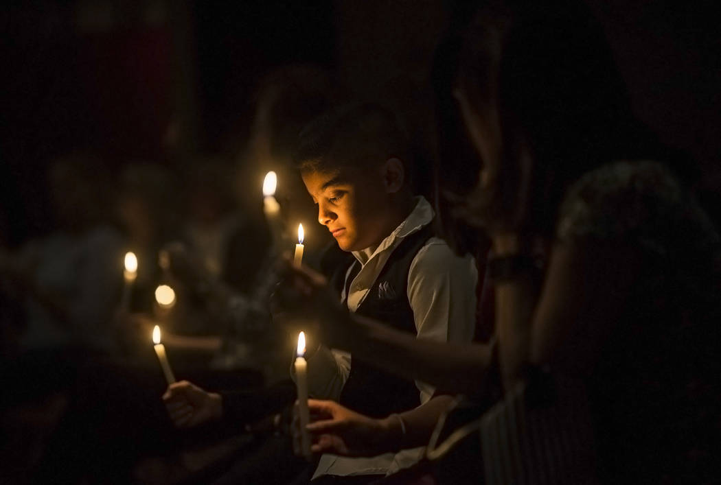 Damascus Bradford prays during a candlelight service in response to Sunday's Route 91 festival shooting on Tuesday, October 3, 2017, at Good Samaritan Lutheran Church, in Las Vegas. Benjamin Hager ...