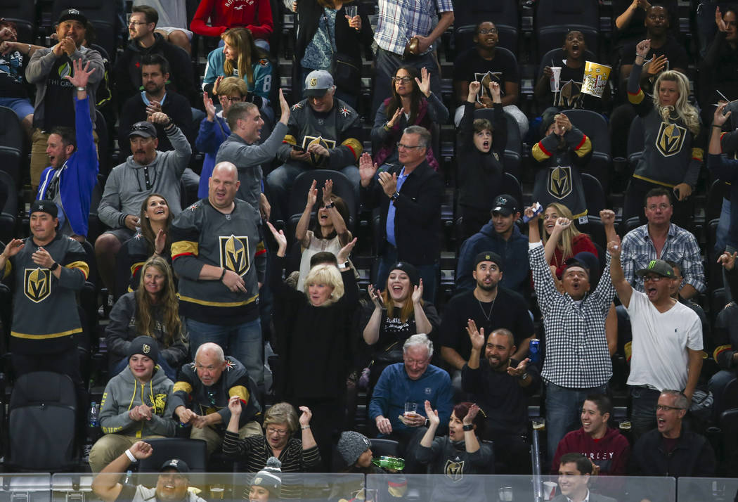 Golden Knights' fans celebrate after a goal was scored against the San Jose Sharks by Golden Knights' Erik Haula (56) during the first period of an NHL preseason hockey game at T-Mobile Arena in L ...