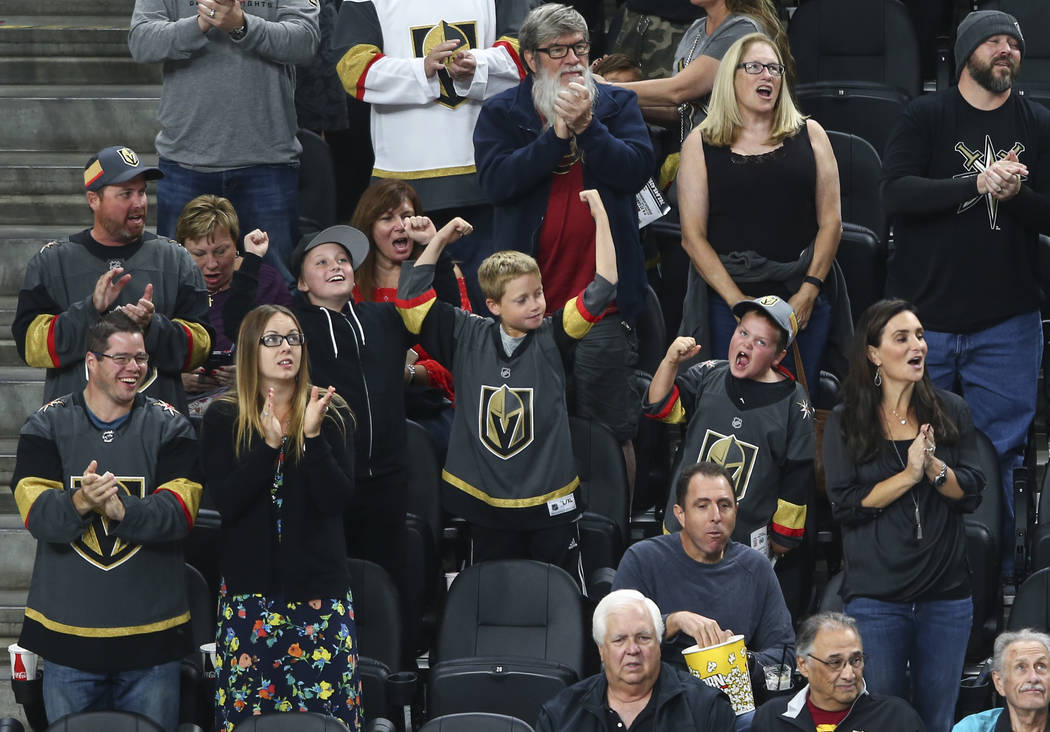 Golden Knights fans cheer during the first period of an NHL preseason hockey game against the San Jose Sharks at T-Mobile Arena in Las Vegas on Sunday, Oct. 1, 2017. Chase Stevens Las Vegas Review ...
