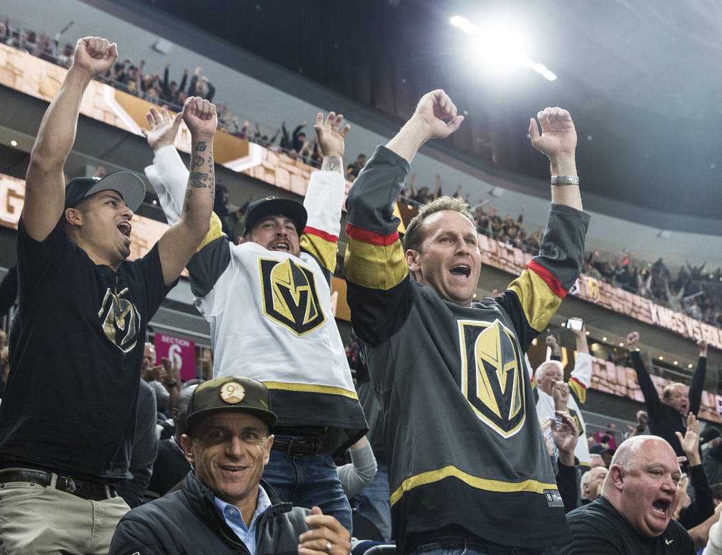 Mike Becker, right, cheers for a first-period goal by the Golden Knights during their first home preseason game with the Los Angeles Kings on Wednesday, September 26, 2017, at T-Mobile Arena, in L ...
