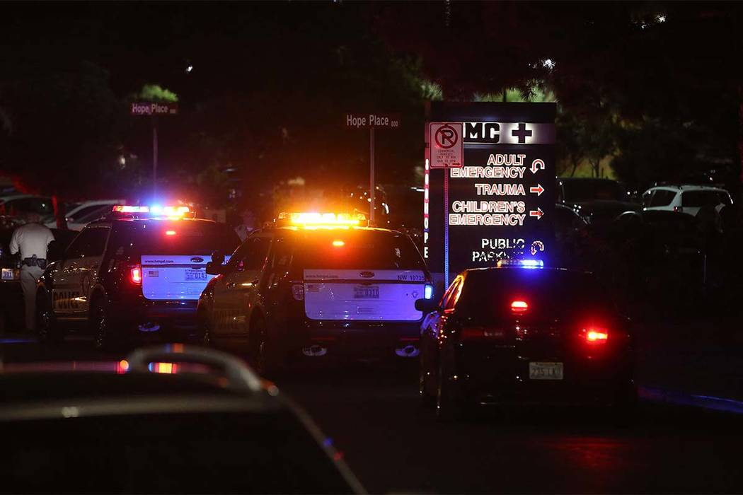 Officers are present outside University Medical Center's Trauma Center on Charleston Boulevard in Las Vegas, Sunday, Oct. 1, 2017. (Bridget Bennett/Las Vegas Review-Journal) @Bridgetkbennett