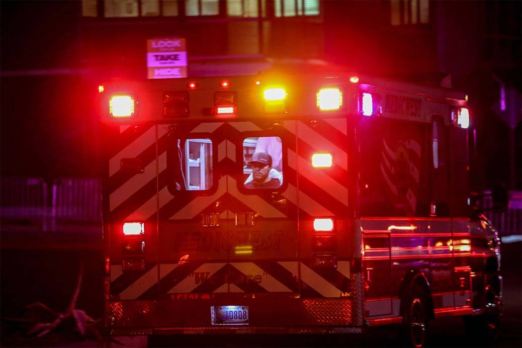 An ambulance with a patient inside rushes to the emergency room at the Sunrise Hospital and Medical Center after a shooting occurred on The Strip in Las Vegas, Monday, Oct. 2, 2017. (Joel Angel Ju ...