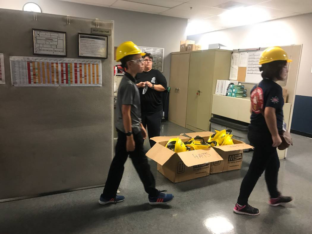 Molasky Junior High School students put on hard hats and get ready for tour of the Metl-Span building on Oct. 4, 2017 at 4700 Engineers Way # 103. (Kailyn Brown/View) @KailynHype