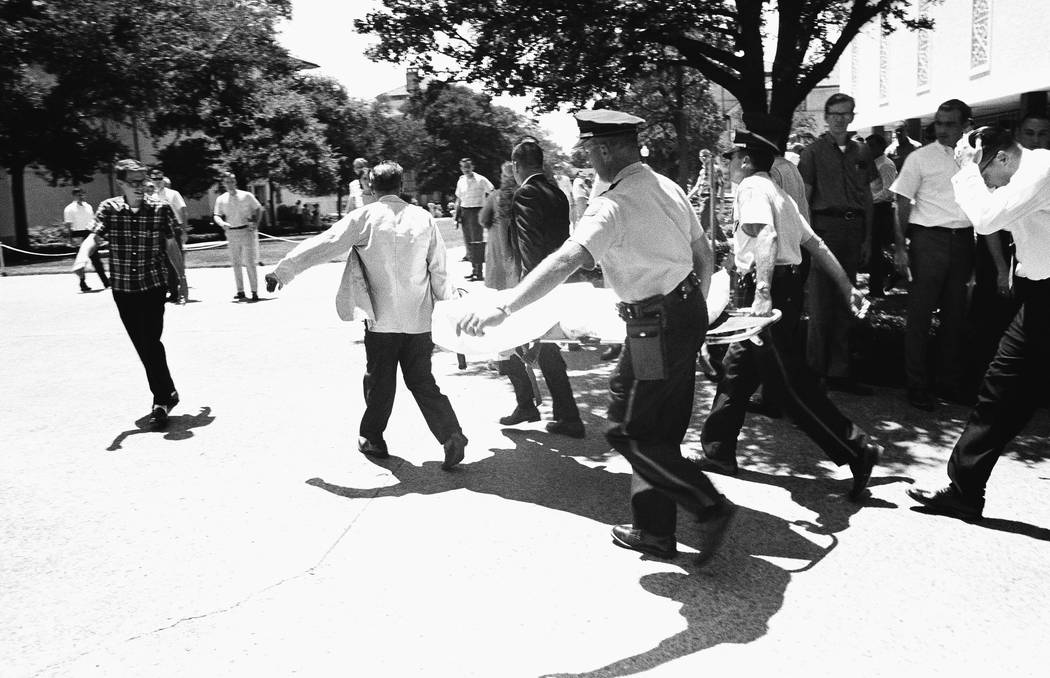 One of the victims of Charles Whitman, the sniper who gunned down victims from a perch in the University of Texas tower, is carried across the campus to a waiting ambulance in Austin in 1996. (AP  ...